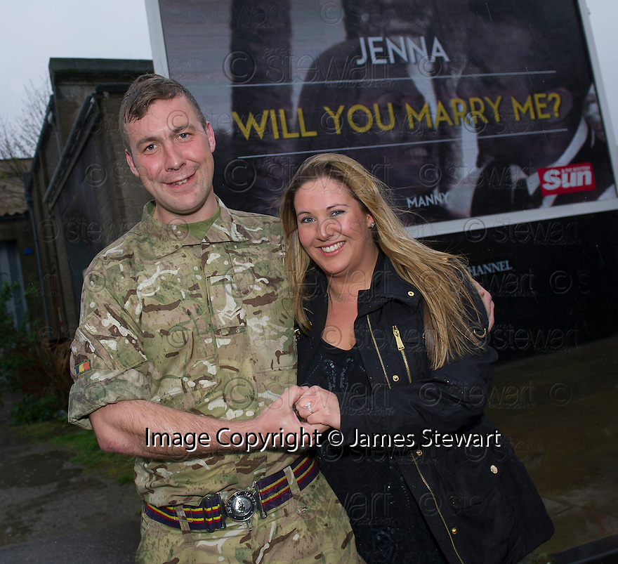 """Jenna Stewart after accepting the wedding proposal from her boyfriend Paul """"Manny"""" Davies after he displayed it on a giant billboard poster in High Street, Kirkcaldy."""