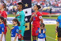 PHILADELPHIA, PA - AUGUST 29: Carli Lloyd #10 stands for the national anthem with a player escort prior to a game between Portugal and the USWNT at Lincoln Financial Field on August 29, 2019 in Philadelphia, PA.