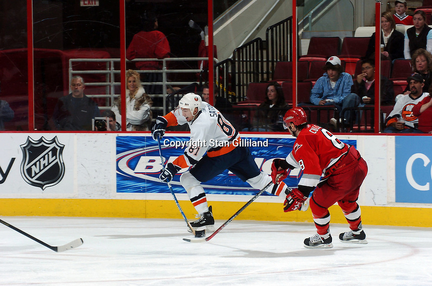 New York Islanders' Miroslav Satan (81) of Slovakia gets a shot off from the corner defended by Carolina Hurricanes' Matt Cullen (8) during their game Thursday, Jan. 19, 2006 in Raleigh, NC. Carolina won 4-3.