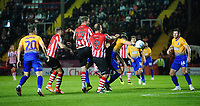 Lincoln City's Jamie McCombe wins a header at a corner<br /> <br /> Photographer Chris Vaughan/CameraSport<br /> <br /> The EFL Checkatrade Trophy Group H - Lincoln City v Mansfield Town - Tuesday September 4th 2018 - Sincil Bank - Lincoln<br />  <br /> World Copyright © 2018 CameraSport. All rights reserved. 43 Linden Ave. Countesthorpe. Leicester. England. LE8 5PG - Tel: +44 (0) 116 277 4147 - admin@camerasport.com - www.camerasport.com