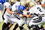 Culver City, CA 09/17/10 - Miles Washington (Culver City #12), Walter Woo (Peninsula #2), Haden Gregory (Peninsula #42) in action during the Peninsula Panthers-Culver City Centaurs varsity football game at Culver City High School.