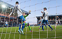 Queen of the South's Mark Durnan handles the ball on the line for Falkirk's second penalty before being sent off.