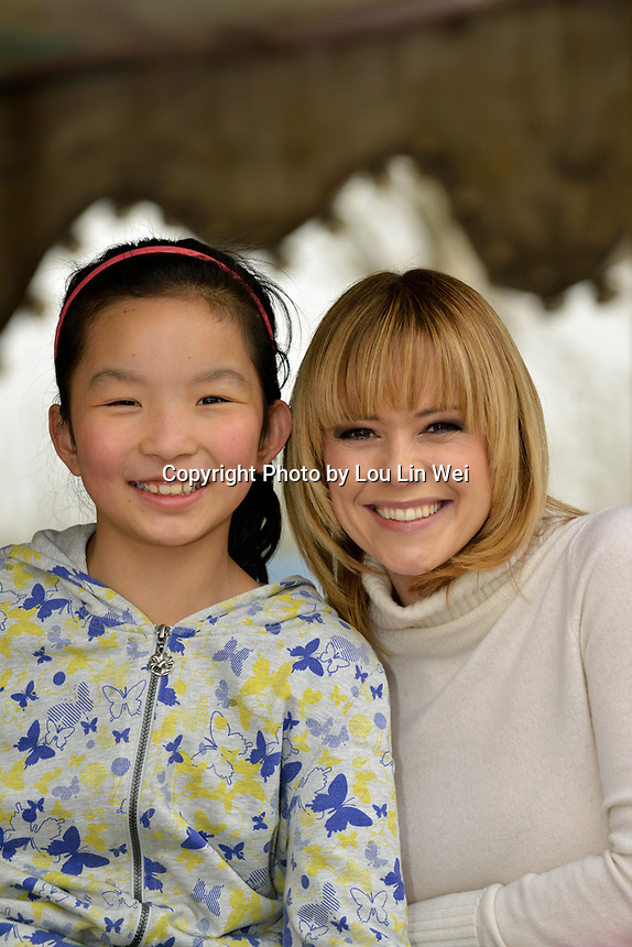 "Swiss singer and TV presenter Francine Jordi visiting ""SOS Kinderdorf"" in Tianjin, China. With Wang Yayu, 10 year old. 22-Mar-2016"