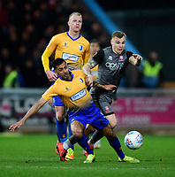 Lincoln City's Harry Anderson vies for possession with Mansfield Town's Malvind Benning<br /> <br /> Photographer Chris Vaughan/CameraSport<br /> <br /> The EFL Sky Bet League Two - Mansfield Town v Lincoln City - Monday 18th March 2019 - Field Mill - Mansfield<br /> <br /> World Copyright © 2019 CameraSport. All rights reserved. 43 Linden Ave. Countesthorpe. Leicester. England. LE8 5PG - Tel: +44 (0) 116 277 4147 - admin@camerasport.com - www.camerasport.com