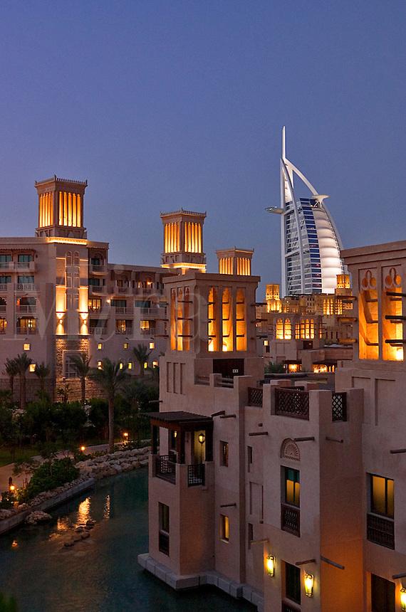 Dubai, United Arab Emirates. Al Qasr Hotel, villas and Burj al Arab Hotel.  Evening. .