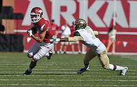 NWA Media/Michael Woods --10/25/2014-- w @NWAMICHAELW...University of Arkansas receiver Cody Hollister tries to get away from UAB defender Lamarcus Farmer in the 1st quarter of Saturday's game at Razorback Stadium in Fayetteville.