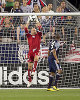 New England Revolution goalkeeper Matt Reis (1) calmly reaches up to make a save. The New England Revolution defeated Monarcas Morelia in SuperLiga 2010 group stage match, 1-0, at Gillette Stadium on July 20, 2010.
