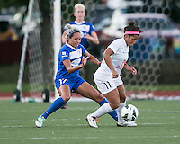 In a National Women's Soccer League Elite (NWSL) match, the Boston Breakers defeated the FC Kansas City, 1-0, at Dilboy Stadium on August 10, 2013.  Boston Breakers forward Kyah Simon (17) prepares to defend against FC Kansas City midfielder Desiree Scott (11),