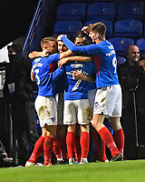 Brett Pitman of Portsmouth second left is mobbed after scoring to make the score 2-1 during Portsmouth vs Altrincham, Emirates FA Cup Football at Fratton Park on 30th November 2019