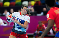 25 JUL 2012 - LONDON, GBR - Ewa Palies (GBR) (left) of Great Britain looks for a way past the Spanish defence during the women's London 2012 Olympic Games warm up handball match at The Copper Box in the Olympic Park, in Stratford, London, Great Britain .(PHOTO (C) 2012 NIGEL FARROW)