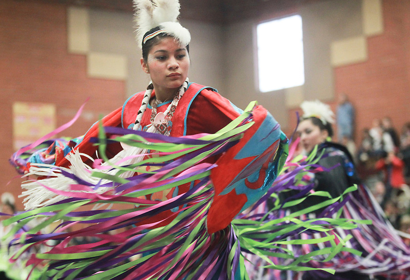 Felicia Florendo, 18 a Lewis and Clark Senior, dances at The Native American Indian Education Program's annual Traditional Powwow in Vancouver, Saturday March 1, 2014.  (Natalie Behring/for the Columbian)