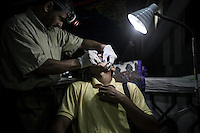 In this Thursday, Aug. 08, 2013 photo, a dentist attends a cavity patient at the field hospital of the sit-in at Al-Raba'a Alawya in the Nasr district of Cairo. (Photo/Narciso Contreras).
