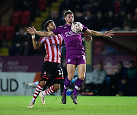 Carlisle United's Jack Sowerby shields the ball from Lincoln City's Bruno Andrade<br /> <br /> Photographer Chris Vaughan/CameraSport<br /> <br /> The Emirates FA Cup Second Round - Lincoln City v Carlisle United - Saturday 1st December 2018 - Sincil Bank - Lincoln<br />  <br /> World Copyright © 2018 CameraSport. All rights reserved. 43 Linden Ave. Countesthorpe. Leicester. England. LE8 5PG - Tel: +44 (0) 116 277 4147 - admin@camerasport.com - www.camerasport.com