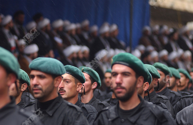 For the attention of foreign pix-For story by Neil MacFarquhar-Hezbollah soldiers marched in celebration of Jerusalem day in the town of Nabatieh in south Lebanon.  Amongst a crowd of 4,500 they were watched by a number of mullahs in the stands behind.  The day was introduced to the Islamic world by Ayatollah Khomeini in 1979 after the revolution in Iran.<br />