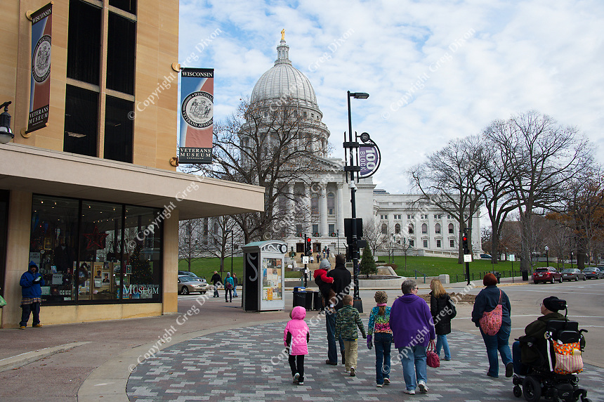 People walk by the Wisconsin Veterans Museum in downtown Madison, Wisconsin on Saturday, November 28, 2015