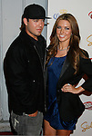 SANTA MONICA, CA. - May 13: Audrina Patridge and guest arrive at the Maxim's 10th Annual Hot 100 Celebration at The Barker Hangar on May 13, 2009 in Santa Monica, California.