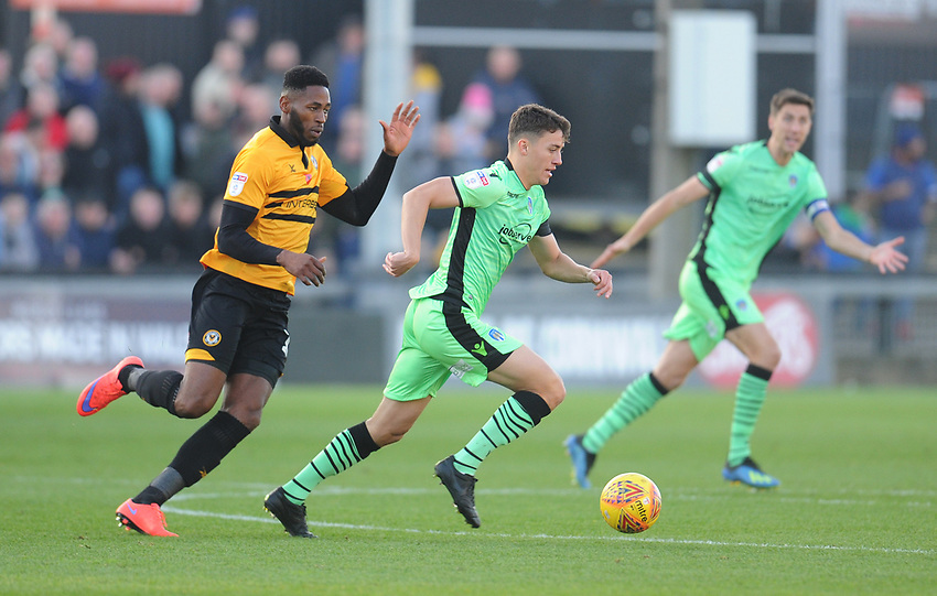 Colchester United's Diaz Wright under pressure from Newport County's Jamille Matt<br /> <br /> Photographer Kevin Barnes/CameraSport<br /> <br /> The EFL Sky Bet League Two - Newport County v Colchester United - Saturday 17th November 2018 - Rodney Parade - Newport<br /> <br /> World Copyright © 2018 CameraSport. All rights reserved. 43 Linden Ave. Countesthorpe. Leicester. England. LE8 5PG - Tel: +44 (0) 116 277 4147 - admin@camerasport.com - www.camerasport.com