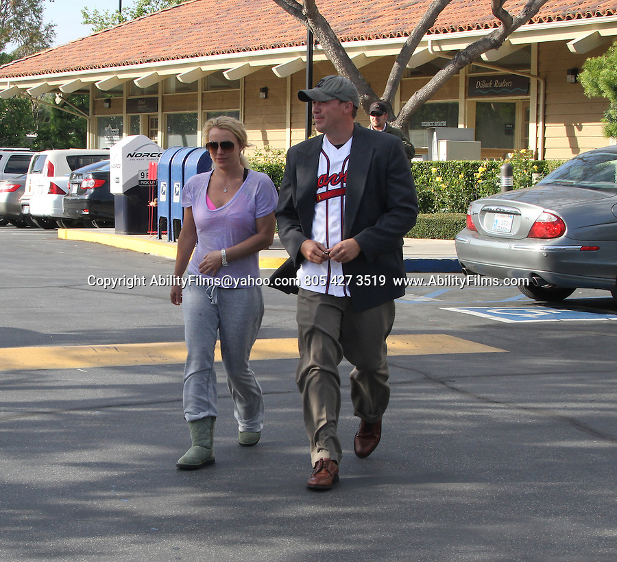 May 7th 2013   Exclusive <br /> <br /> Britney Spears &amp; boyfriend David Lucado holding hands smiling &amp; laughing after eating lunch in Westlake Village California at Pookie Thai restaurant. <br /> <br />  Britney was wearing a purple shirt showing off her pink bra &amp; dirty gray sweat pants with two stains on them &amp; Ugg boots. David was wearing a Braves Baseball jersey &amp; suit jacket <br /> Britney was a little under dressed while her boyfriend was over dressed. <br /> <br /> <br /> AbilityFilms@yahoo.com<br /> 805 427 3519 <br /> www.AbilityFilms.com