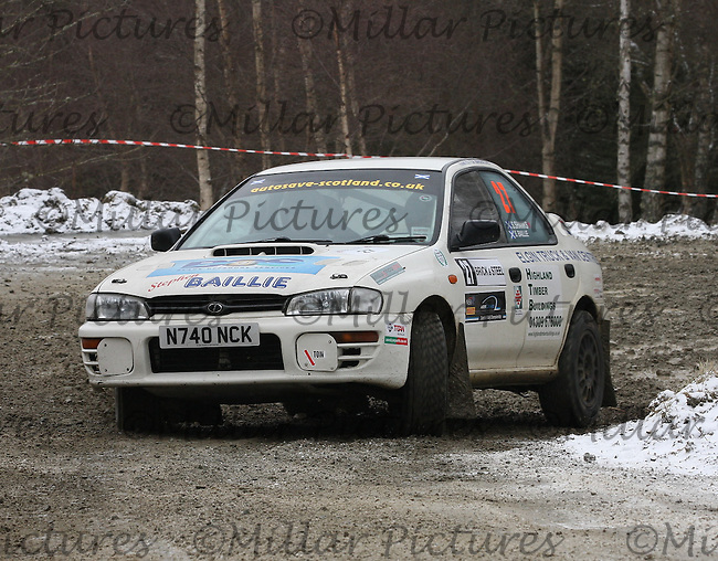Stephen Baillie - Susan Shanks at junction 4 on Special Stage 2 Wauchope on the Brick & Steel Border Counties Rally 2013, Round 2 of the RAC MSA Scottish Rally Championship sponsored by ARR Craib Transport Limited which was organised by Whickham & District and Hawick & Border Car Clubs and based in Jedburgh and held in Kielder Forest on 23.3.13.