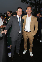 "WESTWOOD, CA - AUGUST 9: Mark Wahlberg, Peter Berg, at Premiere Of STX Films' ""Mile 22"" at The Regency Village Theatre in Westwood, California on August 9, 2018. Credit: Faye Sadou/MediaPunch"
