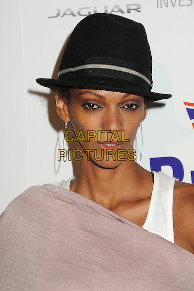 Judi Shekoni.BritWeek 2012 Official Launch held at a Private Residence, Los Angeles, California, USA..April 24th, 2012.headshot portrait white fedora hat black pink earrings .CAP/ADM/BP.©Byron Purvis/AdMedia/Capital Pictures.