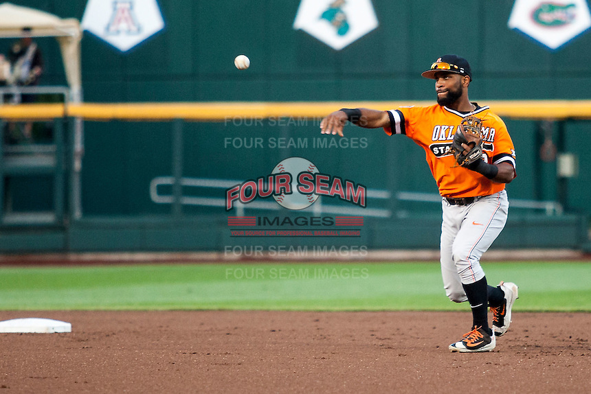 Oklahoma State Cowboys second baseman J.R. Davis (2) makes a throw to first base against the Arizona Wildcats during Game 6 of the NCAA College World Series on June 20, 2016 at TD Ameritrade Park in Omaha, Nebraska. Oklahoma State defeated Arizona 1-0. (Andrew Woolley/Four Seam Images)