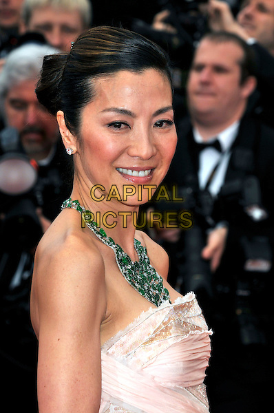 MICHELLE YEOH.Attending the screening of 'You Will Meet a Tall Dark Stranger' presented out of competition at the 63rd Cannes Film Festival, Cannes, France, .15th May 2010..premiere portrait headshot necklace   strapless green smiling hair up bun emeralds emerald beige cream pink.CAP/PL.©Phil Loftus/Capital Pictures.