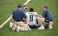 Team officials attend to QB Steve McNair, #9, after he was injured during the NFL AFC Championship game, which the Tennessee Titans won over the Jacksonville Jaguars 33-14 on January 23, 2000 in Jacksonville, FL.  (Photo by Brian Cleary/bcpix.com)