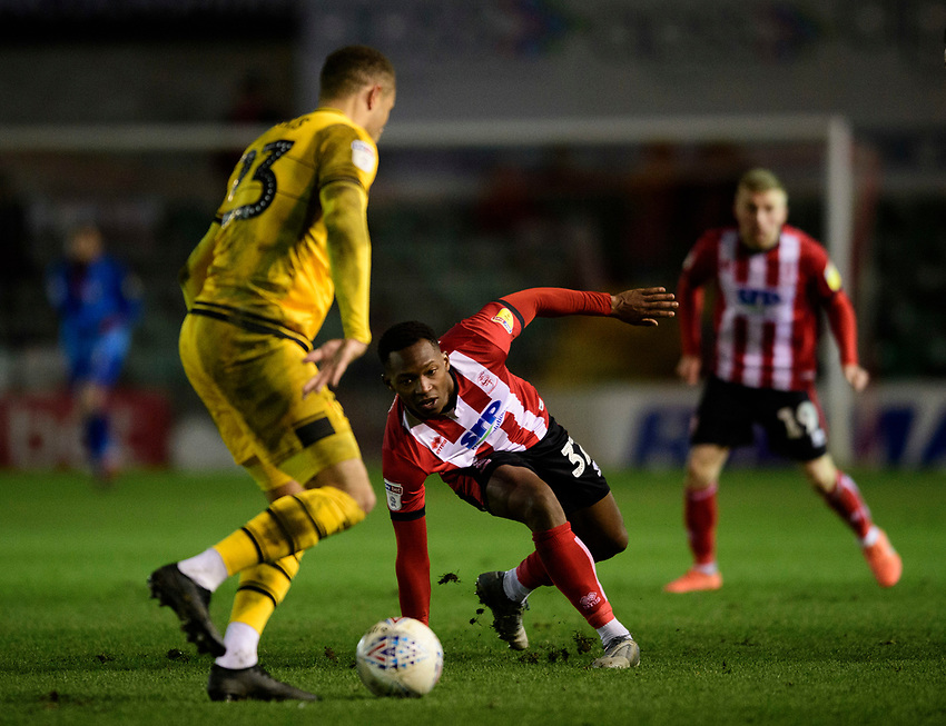 Milton Keynes Dons' Carlton Morris under pressure from Lincoln City's Tayo Edun<br /> <br /> Photographer Chris Vaughan/CameraSport<br /> <br /> The EFL Sky Bet League One - Lincoln City v Milton Keynes Dons - Tuesday 11th February 2020 - LNER Stadium - Lincoln<br /> <br /> World Copyright © 2020 CameraSport. All rights reserved. 43 Linden Ave. Countesthorpe. Leicester. England. LE8 5PG - Tel: +44 (0) 116 277 4147 - admin@camerasport.com - www.camerasport.com