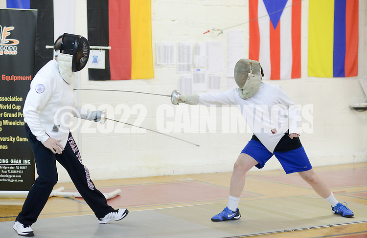 Matthew Mitchell of Glenside, Pennsylvania and his son Eric Mitchell, 16 practice fencing at Liberty Fencing Club April 7, 2015 in Warrington, Pennsylvania.  (Photo by William Thomas Cain/Cain Images)