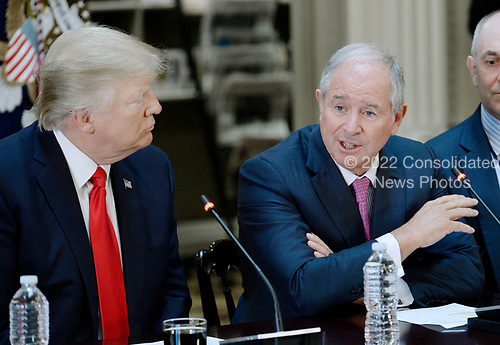 Stephen A. Schwarzman,  Chairman, CEO and Co-Founder of Blackstone speaks as United States President Donald Trump looks on  during a strategic and policy discussion with CEOs in the State Department Library in the Eisenhower Executive Office Building (EEOB) in Washington, DC, April 11, 2017.<br /> Credit: Olivier Douliery / Pool via CNP