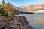Gooseberry Falls State Park, MN: Sunset clouds over Lake Superior shoreline from rock outcrop with birch in fall color