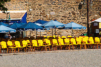 Cafes on the beach with colourful sun shade umbrellas. The beach in the village. Blue and yellow. Collioure. Roussillon. France. Europe.
