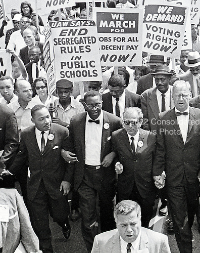Reverend Dr. Martin Luther King, Jr, left, and other civil rights leaders hold hands as they lead a crowd of hundreds of thousands at the March on Washington for Jobs and Freedom, Washington DC, August 28, 1963. Also pictured is Rabbi Joachim Prinz, right center.<br /> Credit: Arnie Sachs / CNP