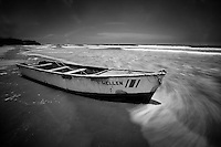Row boat on beach with surf, Costa Rica