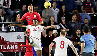 ORLANDO, FL - NOVEMBER 15: Aaron Long #3 of the United States heads a ball past Jonathan David #20 of Canada during a game between Canada and USMNT at Exploria Stadium on November 15, 2019 in Orlando, Florida.