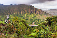 "An aerial view of the Ko'olau mountain range and H-3 Freeway in Haiku valley at dawn from the Haiku Stairs (""Stairway to Heaven"") hiking trail in Kaneohe, O'ahu"