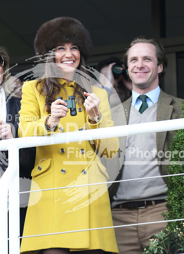 Pippa Middleton and Tom Kingston watching the racing at the Cheltenham Festival, Thursday, 14th  March 2013.  Photo by: Stephen Lock / i-Images / DyD Fotografos