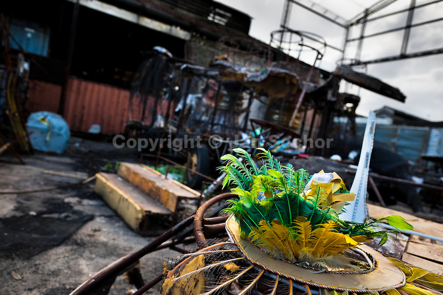 A damaged feather costume thrown on the work yard behind the Samba school workshops in Rio de Janeiro, Brazil, 15 February 2012. Most of the large carnival floats, colorful designs and fancy costumes are dismantled, cut into pieces or simply thrown into garbage right after the last day of the Carnival. The low-tech materials as fiberglass, plastic or polystyrene, which most of the of the carnival floats and statues are made of, are stocked in the warehouses to be recycled and used in the future parades. However, there is no use for some of the statues so they slowly fall apart into pieces forming a ?Carnival cemetery? in the industrial yards around the port of Rio de Janeiro.
