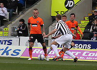 Johnny Russell being closed down by Marc McAusland in the St Mirren v Dundee United Clydesdale Bank Scottish Premier League match played at St Mirren Park, Paisley on 27.10.12.