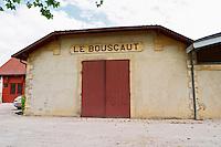 The winery with a sign saying Le Bouscaut Chateau Bouscaut Cru Classe Cadaujac Graves Pessac Leognan Bordeaux Gironde Aquitaine France