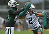 Gabe Marks #2, New York Jets wide receiver, right, muscles his way through blockers during the first day of offseason training activity at the Atlantic Health Jets Training Center in Florham Park, NJ on Tuesday, May 23, 2017.