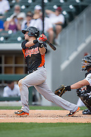 Paul Janish (11) of the Norfolk Tides follows through on his swing against the Charlotte Knights at BB&T BallPark on June 7, 2015 in Charlotte, North Carolina.  The Tides defeated the Knights 4-1.  (Brian Westerholt/Four Seam Images)
