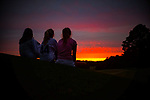 Annie Snell, Liza Goodson and Megan Manuel watch the sunset from the ninth green on the Ole Miss Golf Course. Photo by Robert Jordan/Ole Miss Communications