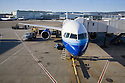 Commercial airplane at a gate at San Francisco International Airport. San Francisco, California, USA