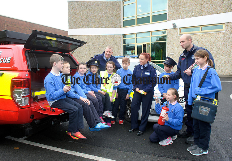 Calum Berry, Simon Magula, Leona Ryan, Liz Sanchez, Allanah Mulqueen, Kasper Kuczaj, Giovanni Makula, Kate Cernova and Karina Galka, pupils of Ennis Holy Family senior school, being taught Halloween safety as part of operation Tombola with Ennis Community Policing officers Deirdre Doherty and Denis Collins as well as firefighter David Woods. Photograph by John Kelly.