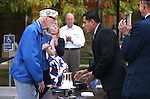 Veteran Charles Sehe talks to Veterans Policy Analyst Cesar Melgarejo following a ceremony at the U.S.S. Nevada Memorial on the Capitol grounds in Carson City, Nev., on Wednesday, Oct. 14, 2015. Sehe served on the U.S.S. Nevada during World War II. <br /> Photo by Cathleen Allison
