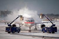 De-icing an airplane.