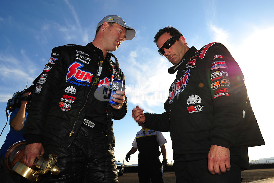 Feb. 19, 2012; Chandler, AZ, USA; NHRA pro stock driver Jason Line (left) after defeating teammate Greg Anderson to win the Arizona Nationals at Firebird International Raceway. Mandatory Credit: Mark J. Rebilas-