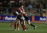 Munster flanker CJ Stander spills the ball in the tackle.<br /> RaboDirect Pro12<br /> Newport Gwent Dragons v Munster<br /> Rodney Parade - Newport<br /> 29.11.13<br /> &copy;Steve Pope-SPORTINGWALES